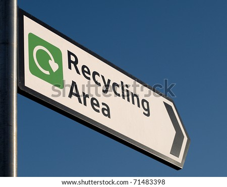Sign to recycling area - stock photo