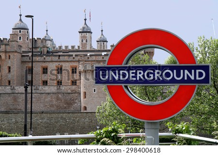 sign underground and towers of London - stock photo
