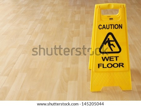 Sign warning of cleaning in progress on a wet floor. - stock photo