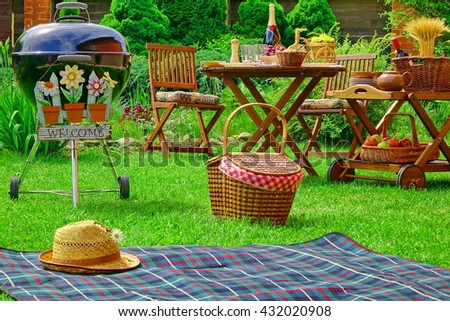 Sign Welcome, Picnic Blanket, Straw Hat, Barbecue Grill Appliance, Hamper, Wooden Chairs And Lunch Table With s On The Backyard Lawn. Outdoor Summer Family Home Party Or Picnic Concept - stock photo