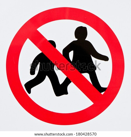 Sign with a simple symbol forbidding children - stock photo