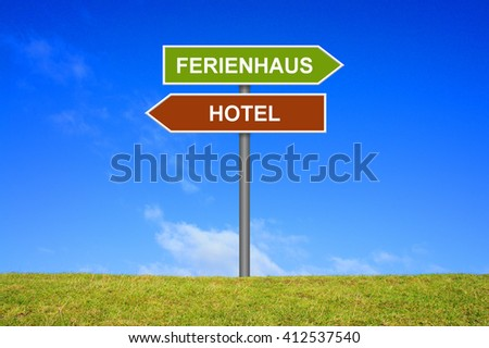 Sign with two arrows shows Hotel or Holiday Home in german language