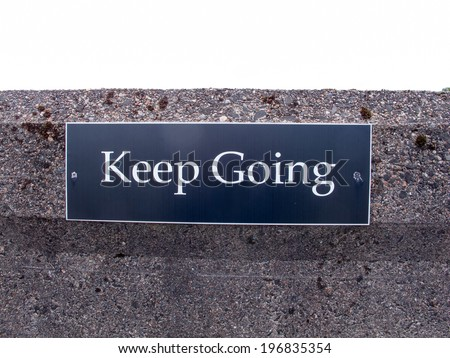 """Sign with words """"Keep Going"""" - stock photo"""