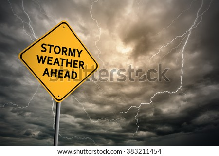 Sign with words 'Stormy weather ahead' on a background of thunderclouds with lightnings - stock photo