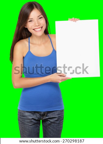Sign woman holding showing white blank paper placard. Smiling happy young asian girl in tank top Isolated on green screen chroma key background.
