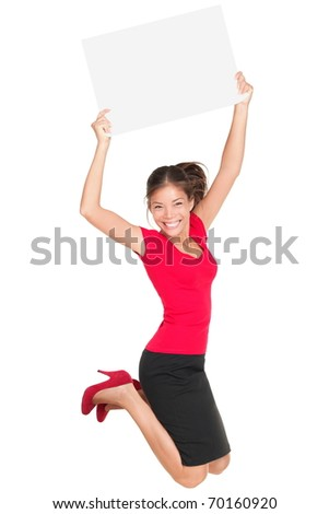Sign woman jumping excited and happy showing blank empty sign card with copy space for your text. Beautiful smiling young female model isolated in full length on white background. - stock photo