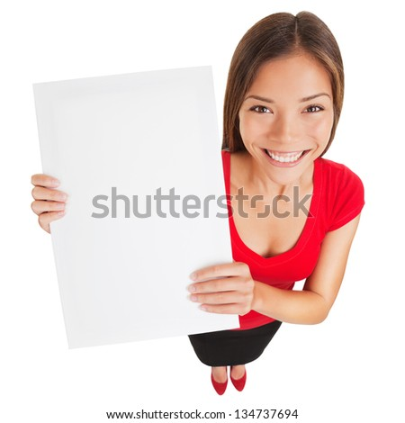 Sign woman showing blank poster billboard. Portrait in high angle perspective of beautiful charming woman with smile holding up a blank white sign for your attention isolated on white background - stock photo