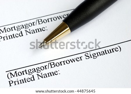 Sign your name here on the mortgage application