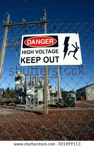 Signage warns people against accessing an electrical sub-station