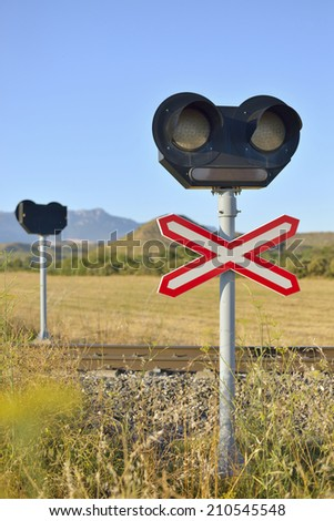 Signal level crossing without barriers, and traffic light. - stock photo