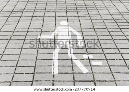 Signal pedestrian walking on urban street, outside - stock photo