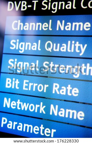 Signal quality menu on a modern television set showing channel name, signal quality, signal strenght, bit error rate, network name and paramenter variables - stock photo