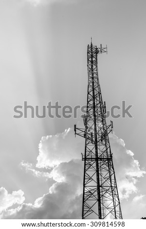 Signal tower on blue sky background,black and white color  - stock photo