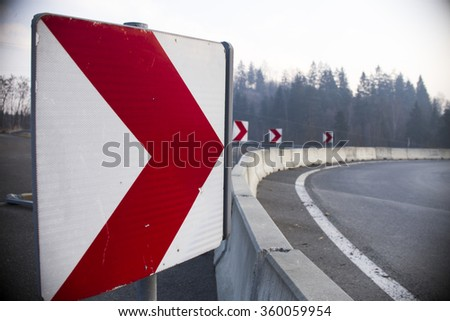 Signal turn right on country road - stock photo