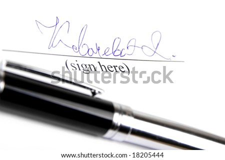 Signature and pen on white background