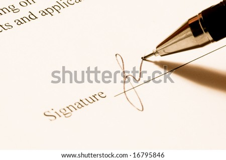 Signature. Close-up of a pen. - stock photo