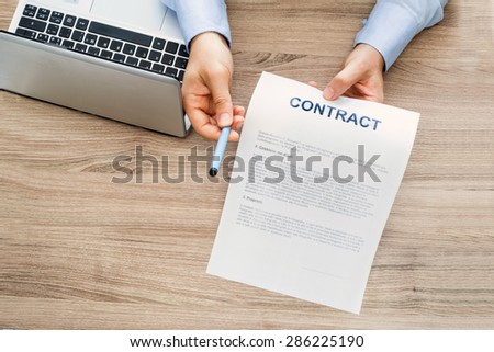 signature of the employment contract - stock photo