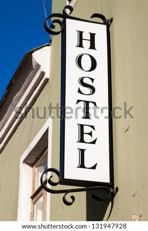 Signboard of the main entrance of a hostel - stock photo