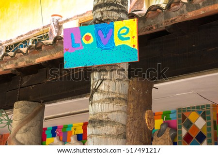 Signboard that says Love on the beach of Sayulita, Nayarit.
