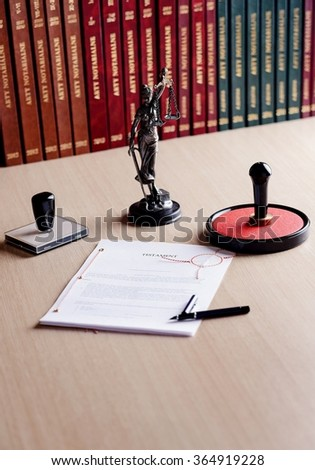 Signed last will on notary public desk. Notary public accessories - stock photo