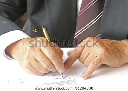 Signing a form - stock photo