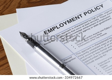 signing an employment policy document