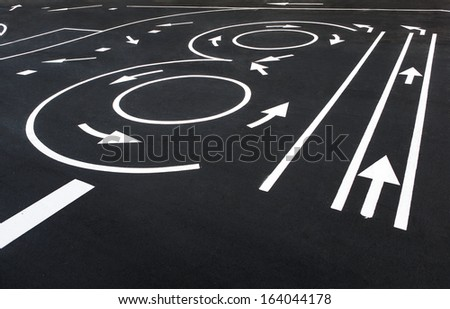 Signing and pavement-marking / photography of road markings and traffic symbol on surface road  - stock photo
