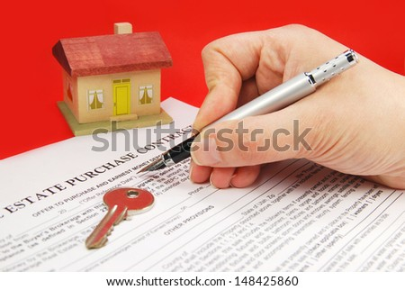 Signing document for new home / Real Estate Contract - stock photo