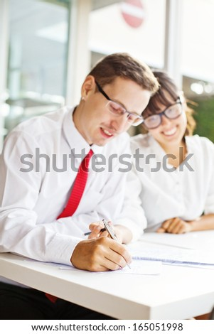 signing documents (soft focus on a pen) - stock photo
