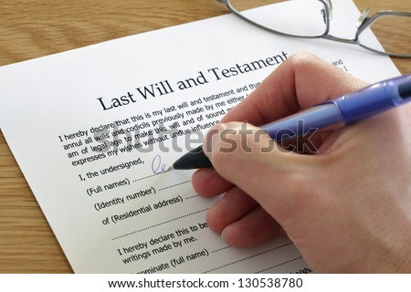 Signing Last Will and Testament document - stock photo