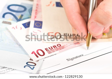 signing on a business form - stock photo