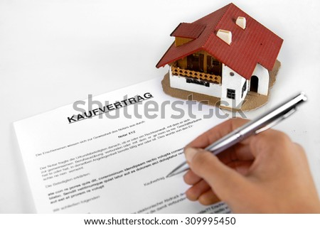 "Signing real estate contract - Concept with the German Word ""Kaufvertrag"""