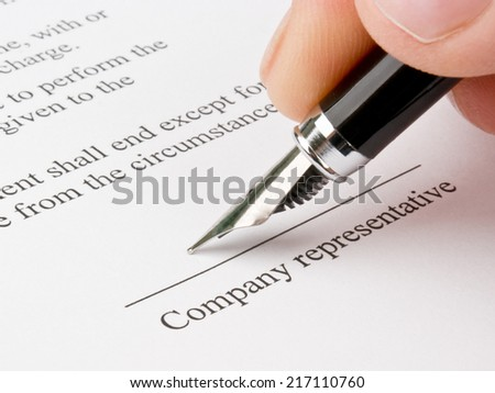 Signing the contract (agreement) - stock photo
