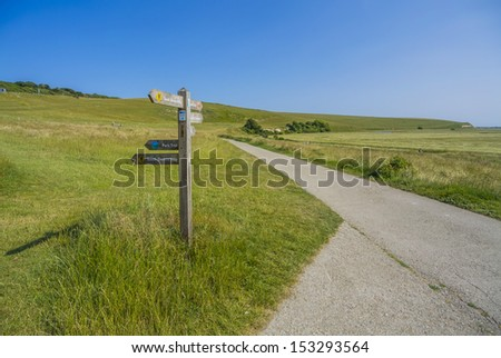 signpost and footpath in the cuckmere haven river and country park sussex uk - stock photo