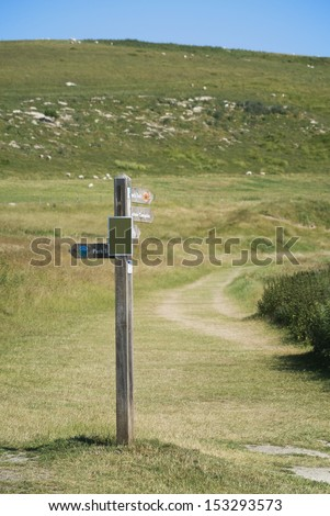 signpost and footpath in the cuckmere haven river and country park sussex uk