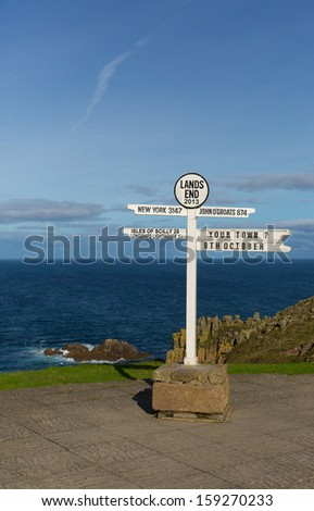 Signpost at Land`s End Cornwall UK the most westerly point of England on the Penwith peninsula eight miles from Penzance on the Cornish coast