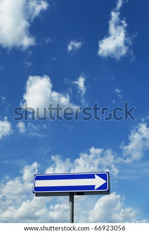 signpost - direction under a blue cloudy sky