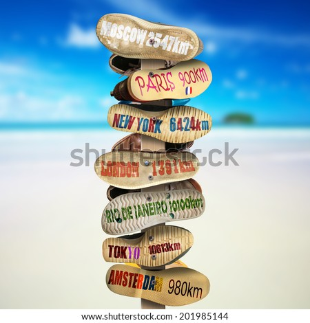 Signpost is made of old worn shoes, the distance to the cities - stock photo