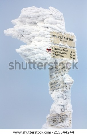 signpost on top of Kralicky Sneznik or Snieznik Klotzky - border of Czech Republic and Poland - water divide for Black sea, Baltic sea and North sea  - stock photo