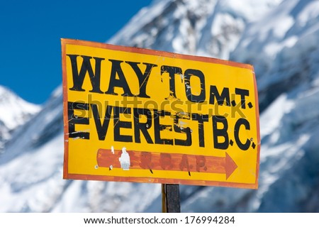 Signpost on trekking route to Mt. Everest Base camp at Khumbu Glacier near Gorak Shep, Solu Khumbu, Nepal. - stock photo