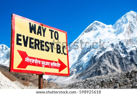 Signpost to the Mount Everest Base Camp. View of Everest and Nuptse from Kala Patthar.
