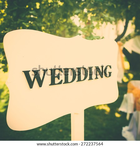 Signpost to the wedding ceremony, old style. Toned with retro vintage instagram filter effect. - stock photo