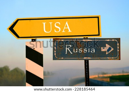 signpost to USA or Russia. choice, decision - stock photo
