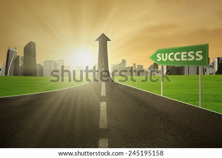 Signpost with a Success text pointing at an highway turning into arrow upward, symbolizing a road to success - stock photo