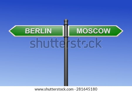 Signpost with arrows pointing two directions - towards Berlin and Moscow.  - stock photo