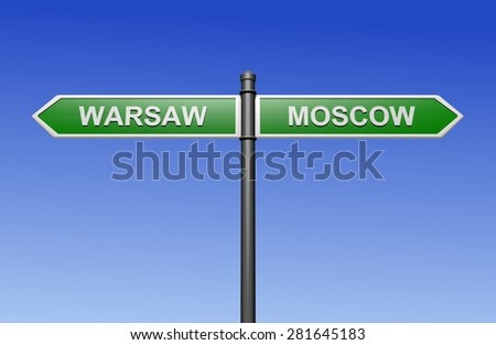 Signpost with arrows pointing two directions - towards Warsaw and Moscow.