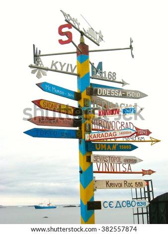 Signpost with Cities (Vernadsky Ukrainian Research Station, Antarctica) - stock photo
