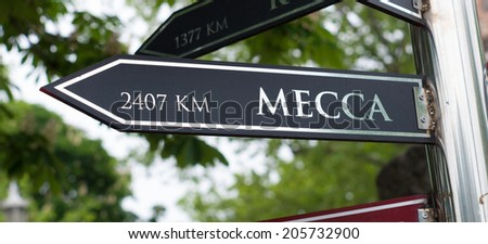 signpost with distance to Mecca in Istanbul, turkey - stock photo