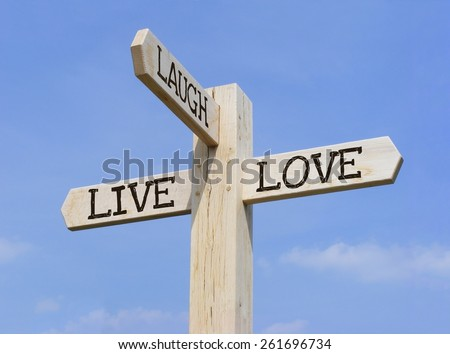 """Signpost with the words """"Live Laugh Love"""" over a blue sky background - stock photo"""