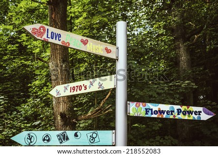 signpost with vintage messages from sixties and seventies